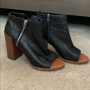 Dolce Vita black leather peep toe bootie. 9 1/2